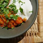 Plant-based bowl with yoghurt and parsley
